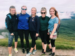 Megan and her friends after walking to the top of a Munro